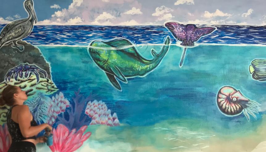 fish swimming underwater/above water