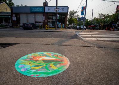 Yaara Eshet's green sidewalk decal with illustrations of a fox and wildlife.